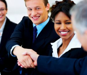 Two people shaking hands at international business meeting.
